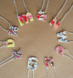 These are so sweet. Floral Alphabet Pendant : kitsch handmade jewellery for spring...shrinky dink inspiration