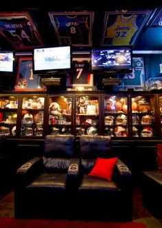 Sports memorabilia fills a man cave that Blake Barnes, a Texans fan, created that can seat about 50 people with multiple tele… – garage Man Cave Basement, Man Cave Garage, Garage Bar, Basement House, Man Cave Diy, Man Cave Home Bar, Sports Memorabilia Display, Best Man Caves, Sports Man Cave