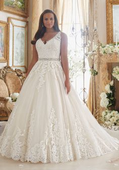 Embroidered Lace Appliques on Tulle Ball Gown with Scalloped Hemline Plus Size Wedding Dress Designed by Madeline Gardner. Removable Beaded Satin Belt included