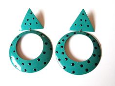 Fab 1980s fashion retro earrings! Large metal 80s dangle hoop earrings with geometric style. Theyre seafoam green with black polka dots. They do not