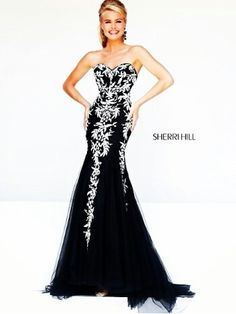 Black dress and white decoration by Sheri Hill Collection