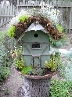 THE FENCE!  #Fairy #House by Urban Sea Star via flickr - love the wood trim and wire over window, well planted in old saucer, stump makes a great stand - #garden #gardening #decor #whimsy - tå√