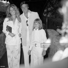Just-married American actors Farrah Fawcett and Lee Majors, along with Majors' son from a previous marriage, Lee Majors II, pose together at the reception following their marriage at the Hotel Bel-Air, Los Angeles, California, July 28, 1973.
