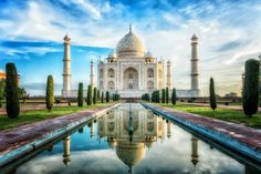 The Taj Mahal in India - one of the Seven Wonders of the Modern World. In 1632 Shah Jahan, the fifth Mogul Emperor of India, began building the Taj Mahal as a monument to his wife and constant companion, Mumtaz Mahal, who had died in childbirth. Famous Monuments, Famous Landmarks, Famous Places, Taj Mahal India, Places Around The World, Around The Worlds, Wonderful Places, Beautiful Places, Beautiful Buildings