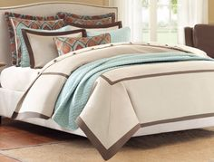 Plume Bedding by Hampton Hill Inspiration from hotel style results in the Plume by #HamptonHill. Plumes #duvet style comforter is a light oak color set with mocha bands that create a border and frame within the face of the #comforter.