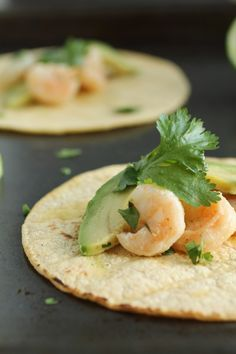 Tequila Lime Shrimp Tacos. Maybe add some roasted red pepper and/or tomatoes. Sour cream?