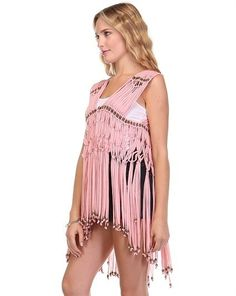 Gorgeous pink vest features a knot tie fringe design with a beaded detail. Perfect over a contrast tank top and shorts. Finish it up with some cute strappy sandals or wedges. Mood: Boho, Casual, Cute