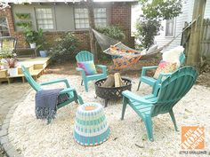 Backyard Makeover With Color and Comfort: Pea gravel patio, with fire pit and hammock