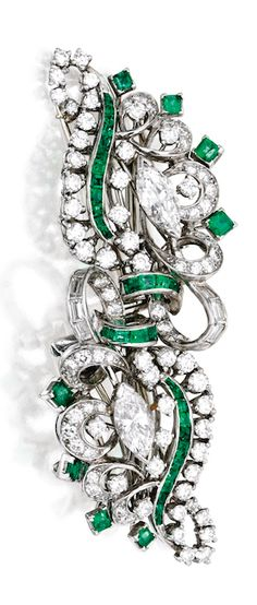 *PLATINUM, DIAMOND AND EMERALD DOUBLE CLIP-BROOCH, J.E. CALDWELL The scrollwork motifs set with two marquise-shaped diamonds weighing approximately 1.35 carats, accented by round and baguette diamonds weighing approximately 3.00 carats, further decorated with square and calibré-cut emeralds, signed JE.C & Co., numbered T9052; circa 1930; with removable carriage for wear as two separate brooches.