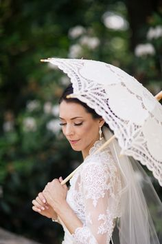 A Victorian parasol is the perfect wedding accessory for a vintage themed wedding! Photo Chris and Becca Photography