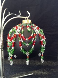 Dazzling red and green crystal beaded ornament cover, accented with silver seed beads and clear crystal drops. Looks great on white or black