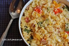 Jamaican Seasoned Rice Recipe Main Dishes with cod fish, cooking oil, bacon, onions, green bell pepper, jamaican pumpkin, cabbage, hot water, hot pepper sauce, ketchup, black pepper, salt, long-grain rice