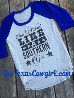 Ain't Nothin' Like a Southern Girl Raglan Baseball Tee Shirt, (http://www.thetexascowgirl.com/aint-nothin-like-a-southern-girl-raglan-baseball-tee-shirt/)