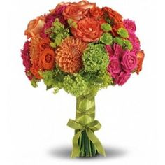 his bright bouquet is fabulously fun and fashionable. Orange and hot pink roses are perfectly paired with orange dahlias, green hydrangea and button spray chrysanthemums, plus green viburnum and accents of lady's mantle. #nycflowers #flowershop #florists #flowers #arrangements #flowergift #dahlias #roses #bouquet