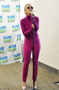 Turning heads: The pop princess highlighted her toned curves with her bold and bright choi...