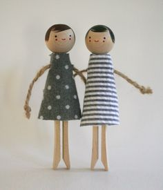 Peg dolls. The dolls have a little neck and jute string arms.