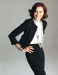 Inès de La Fressange in classic black and white with fun jewelry