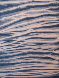 Indigo Shibori by TextileAmelia, via   Flickr  Arashi shibori, natural indigo on cotton  Amelia Poole