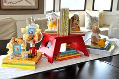 Just like Golden Books, this Golden Books Baby Shower is decorated with a blue, white and gold color palette. Decorations included vintage children's classics – both toys and books.