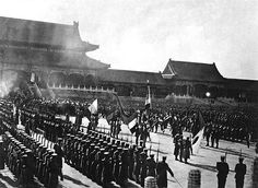 The Eight-Nation Alliance in Beijing following the defeat of the Boxer Rebellion. Immediately identifiable flags in picture: Italy, France, Kaiserliche Marine, Imperial Russian Navy, and Japan, 1900.