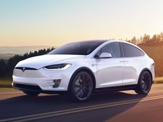 Plugs and Sparks: A Tesla employee use a Model X to pull a semi truc...