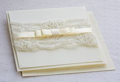 Cream and pearl lace wedding invitations