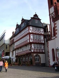 The Römerberg - Frankfurt, Germany. The Römer's (The Roman's Hill) ) silhouette is world-famous and unmistakably belongs to Frankfurt. Formerly called Saturday's Hill, the square was the place for all markets, tournaments, festivals and fairs. The city's government has been located here since the 15th century.
