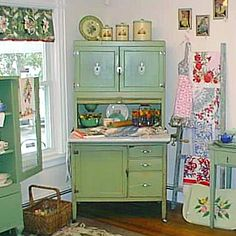 Green 1930's Hoosier Cabinet at T-Party Antiques and Tea Room by The T-Cozy, via Flickr