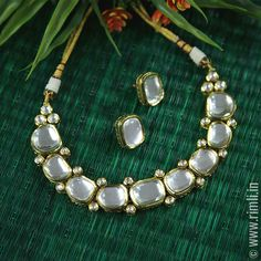 Versatile kundan choker necklace with a classic pair of earstuds.Available in our at T Nagar, Chennai. WhatsApp us at Kundan Jewellery Set, Indian Jewelry Earrings, Indian Jewelry Sets, Fancy Jewellery, Jewelry Design Earrings, Bridal Jewelry Sets, Wedding Jewelry, Mint Jewelry, Kundan Set