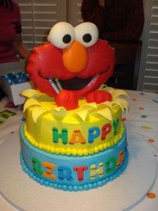 Elmo cake!! Would have been a cute idea since B shares a bday w/ Elmo.  Maybe next year - he doesn't even know who Elmo is right now :)