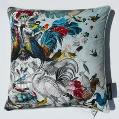 THE ARRIVAL OF THE BIRDS SWAN CUSHION – The stunning array of tropical birds and vibrant colours inspire our imagination to discover the fairy tale behind this illustration. Goode pushes the boundaries of beauty in his work, and this cushion is no exception.  #Cushions #InteriorDesign #Style   Shop the collection at www.inspirehomeproducts.co.uk