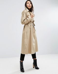 Beige oversized trench coat is a must-have for mid-season weather paired with skinny jeans and black boots