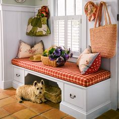 Create a welcome place to pull on shoes or set down packages. Here, a cubby keeps trip hazards safely stowed and drawers help organize small items, such as dog leashes and toys. | Photo: Eric Roth | thisoldhouse.com