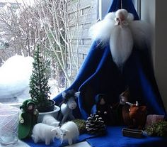 What this made me think of was having a King Winter at the top, and his blue robe (a silk) being the backdrop for the seasons table.