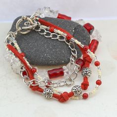 Aphrodite Four Strand Quartz and Red Coral Bracelet from AURAGEMSbyHeather.  Metaphysical note: Greek goddess of love, Aphrodite, embodies all things of beauty, love, and pleasure, so this bracelet made with her in mind needed to include gemstones to reflect her qualities. This piece includes clear quartz for harmony, red coral for passion, and hematite for balance.