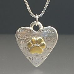 For the total dog lover, this beautiful silver and gold, heart shaped pendant has a bright 24k gold paw on a textured backing. Gold foil was heat fused to the surface of the fine silver paw using the ancient method of Keum Boo. It hangs from a wide silver bale. It measures about 1 1/4 tall and an Dog Jewelry, Heart Jewelry, Silver Jewelry, Jewelry Design, Gold Heart, Gold Foil, Sterling Silver Chains, Heart Shapes, Surface