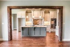 Great four bedroom Craftsman house plan design with open concept living spaces, and a flexible bonus room over the garage. Browse our house plans today! Home, Room Remodeling, Home Renovation, Beams Living Room, Open Kitchen And Living Room, Home Design Plans, Kitchen Style, Modern Farmhouse Kitchens, Craftsman House