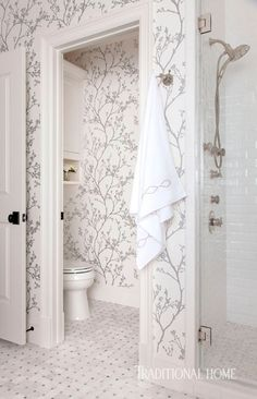 Silvery branches on the bathroom wallpaper dress the space in serenity. - Photo: Ryann Ford / Design: Marie Flanigan
