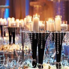 The reception tablescapes alternated between floral centerpieces and mirrored pedestals with candles and hanging crystals.
