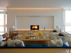 Grouped with a Pawson-designed low table in the family room are Børge Mogensen leather chairs and a custom-made sofa covered in a Loro Piana linen-cashmere.