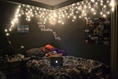 Quotes, Magazine cutouts, and lights = The perfect tumblr bedroom