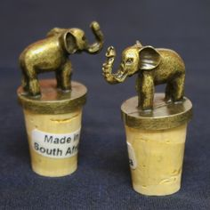 Fair Trade Elephant Animal Bottle Corks Set — handcast in South Africa — find them at @Fairen Moore and Square Imports —These unique wine bottle corks are hand-cast from zinc and electroplated with an antique brass finish. Sold in pairs. Makes a great gift for any wine or animal enthusiast!
