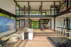 Minus the big tv, I like the open light with all the books.  huf-haus-modum-prefab-house-3
