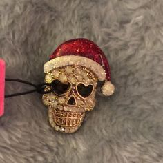 Brand new Betsy Johnson holiday skull pin. firm unless bundled.please no trades, modeling or other forms of payment. Thank you for understanding.  Betsey Johnson Jewelry Brooches