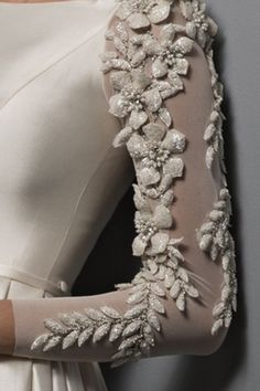 Ivory silk ball-gown with puff flower appliques