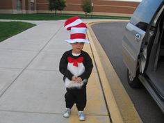 """Cat in the Hat...black sweatsuit with felt bow and fur """"patch"""" pinned on."""