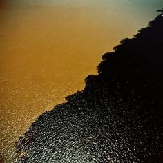 The Meeting of Waters (Portuguese: Encontro das Águas) is the confluence between the Rio Negro (Black river - the largest blackwater river i. Brasil Travel, Latina, River I, Amazon River, Two Rivers, Contemporary Abstract Art, Blue Hole, Birds Eye View, Manaus