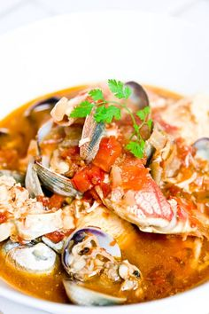 Cioppino is a San Franciscan seafood soup similar to bouillabaisse. This version of Cioppino includes fresh tomatoes, crab, clams, prawns and red snapper.