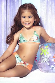 Mar de Rosas Children's Swimwear - Life under the sea comes to life in this adorable matching swim set from Mar de Rosas new 2016 collection. This one of a kind bathing suit has a comfortable triangle top lined with breathable stretch fabric that won't irritate your baby's skin. Your precious baby girl will be as beautiful as her mommy in this magical bikini. She will fall in love with the bright colors and pretty pearls sewn across the front.