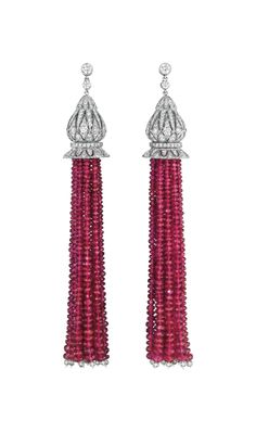 A Pair of Unheated Burma Ruby and Diamond Ear Pendants  Each suspending a tassel of Burmese rubies, each terminating with a rondelle-cut diamond, from an open-work circular-cut diamond cap, to the collet-set diamond link and surmount, mounted in platinum.